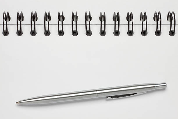 Spiral Note Book with pen stock photo