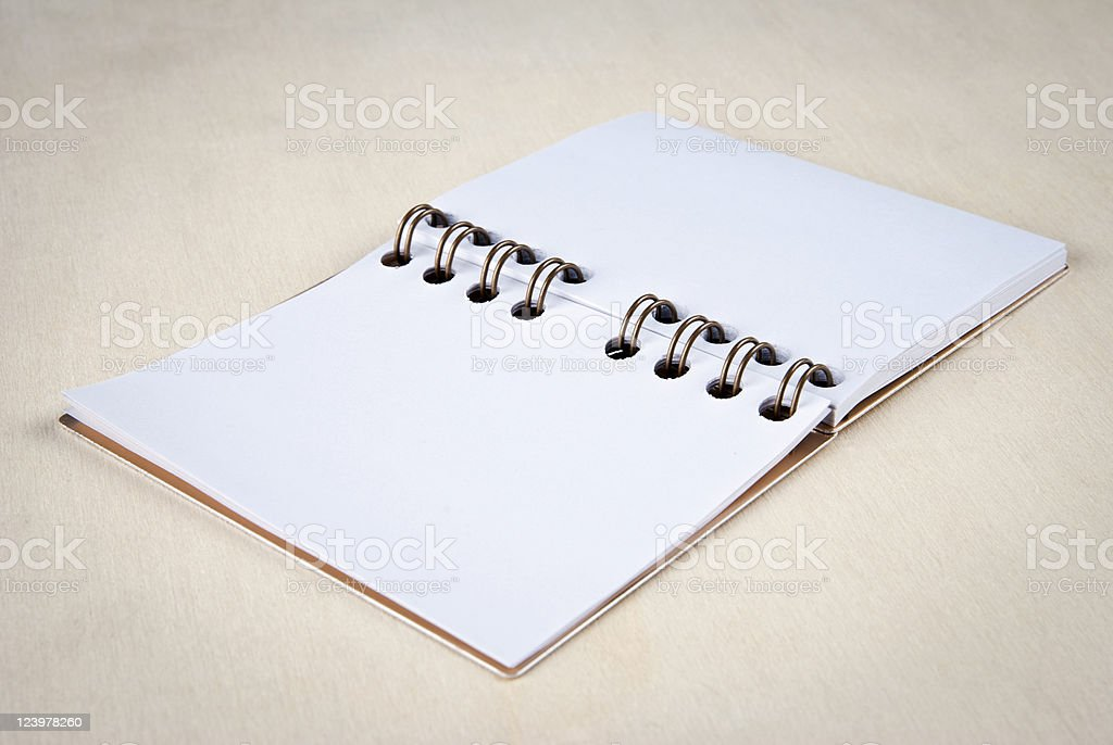 Spiral Notebook Open with Blank White Pages on Wood stock photo