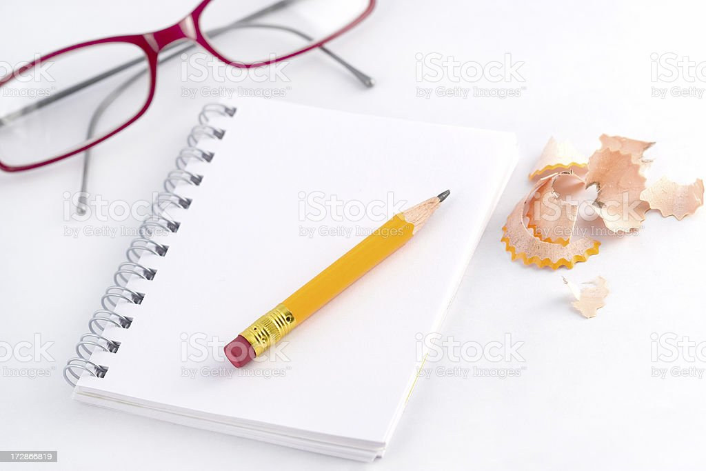 spiral notebook, pencil and glasses royalty-free stock photo