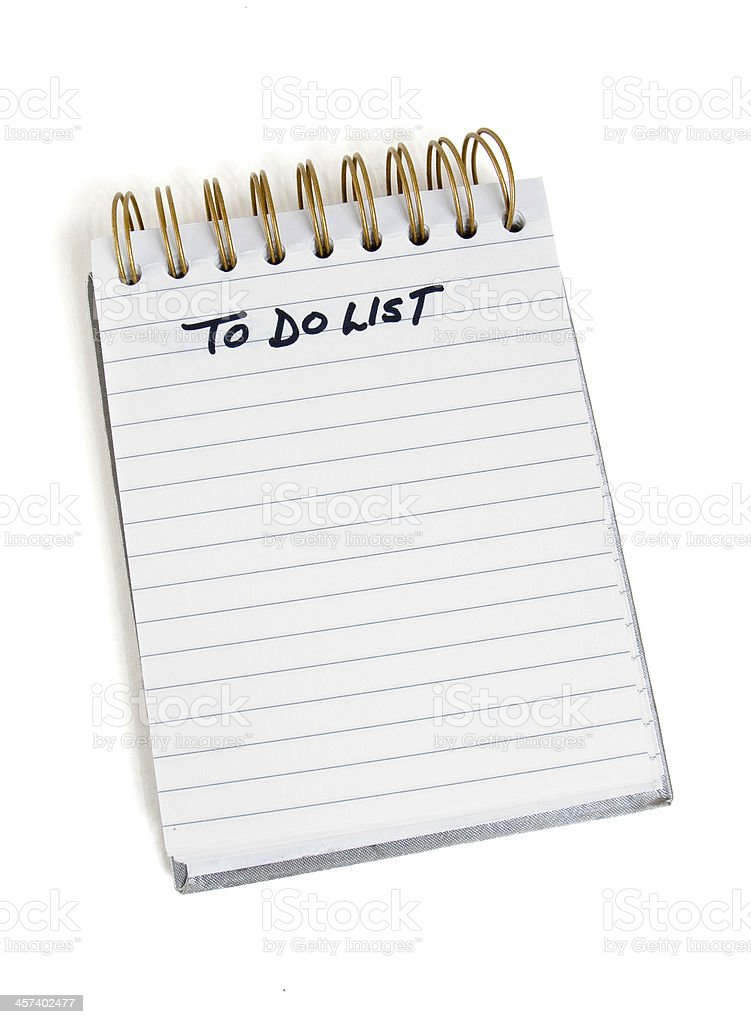 Spiral notebook with a to do list stock photo