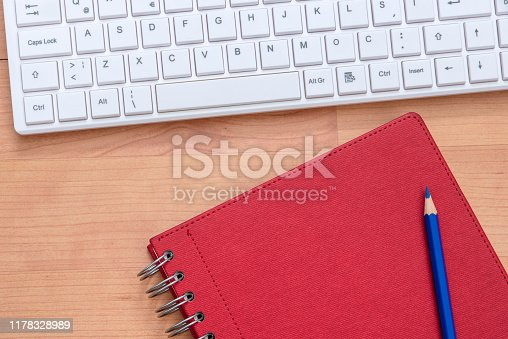 519189026 istock photo spiral notebook with pencil and computer keyboard 1178328989
