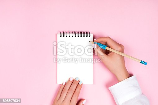 istock Spiral notepad with pencil as mockup for design 696307934
