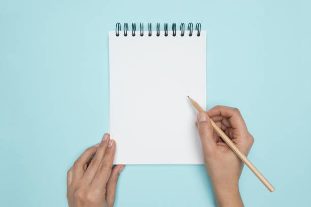 Spiral Notepad with Pencil stock photo