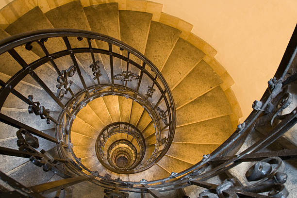 Spiral staircase and stone steps in old tower stock photo