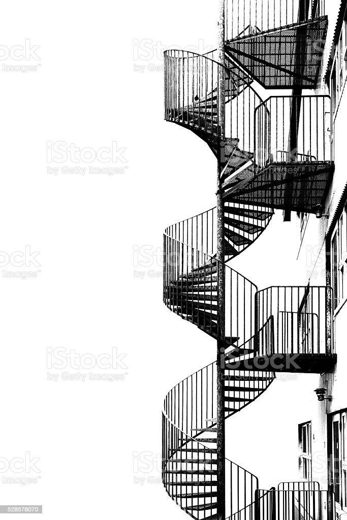Spiral staircase, black and white image. stock photo