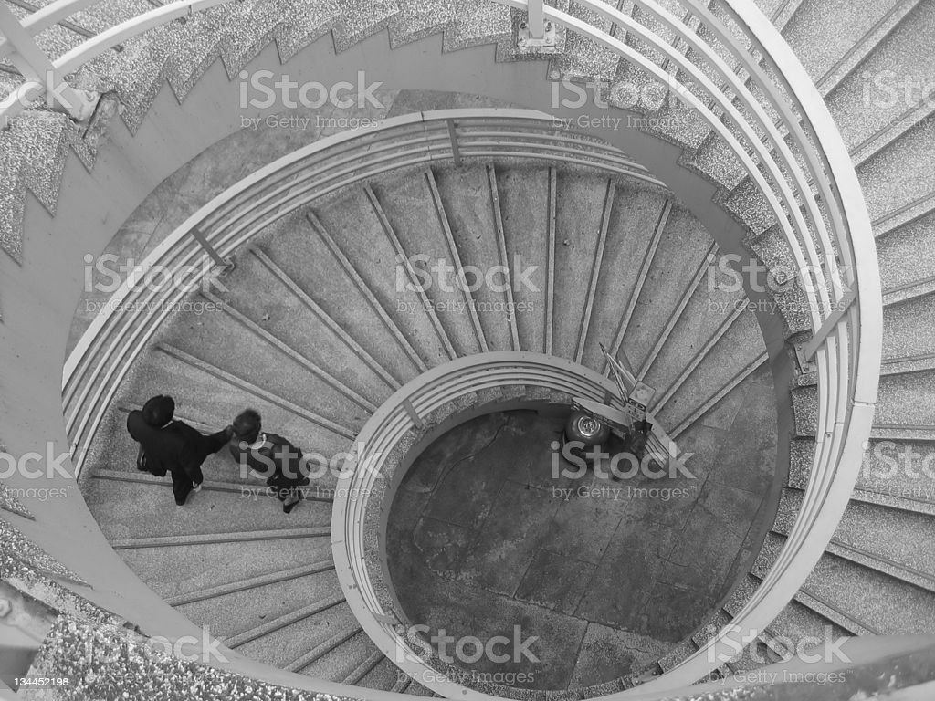 Spiral staircase descent stock photo