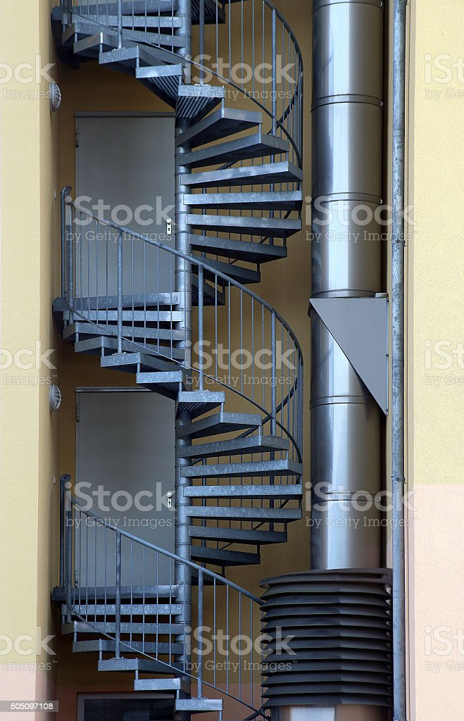 Spiral Staircase. Fire Escape / Emergency Exit Outside Industrial Building  Royalty Free Stock Photo