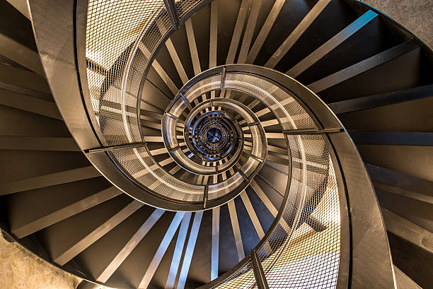Spiral staircase in tower - interior architecture of building stock photo