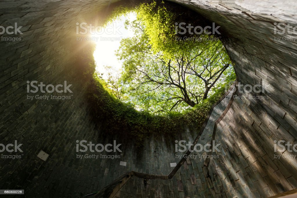 Spiral staircase of underground crossing in tunnel at Fort Canning Park, Singapore stock photo