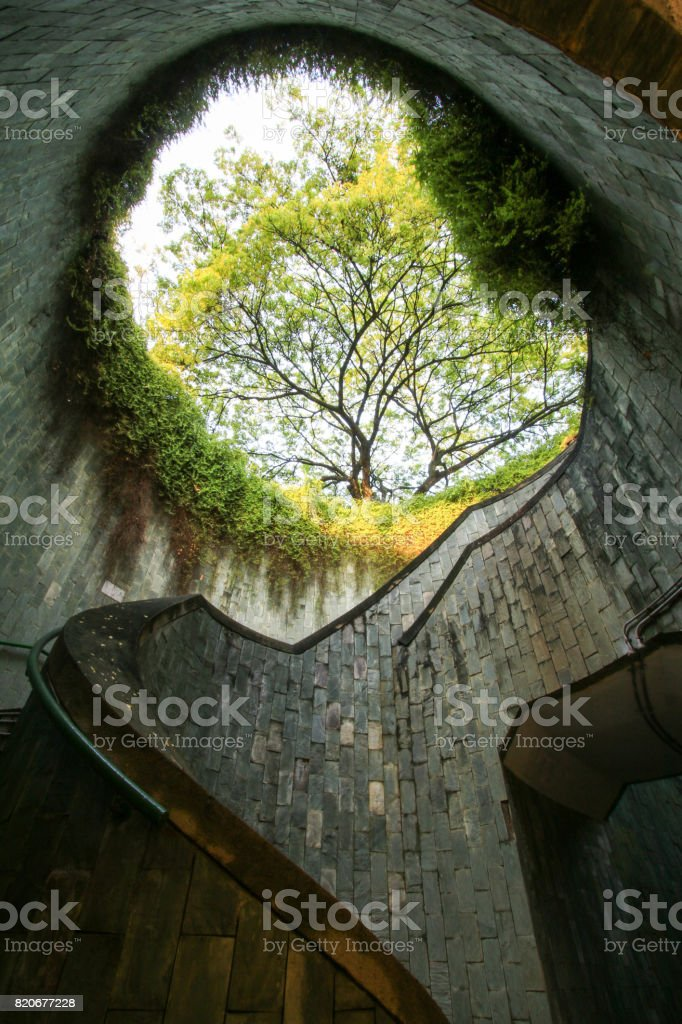Spiral staircase of underground crossing in tunnel at Fort Canning Park, Singapore. stock photo