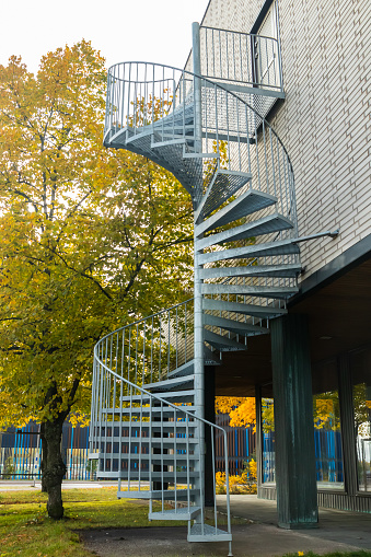 Spiral staircase on the outside of a modern building