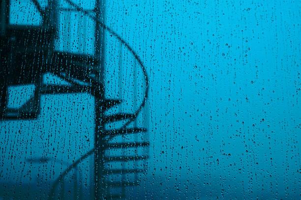 Spiral Staircase Outside Rainy Window stock photo