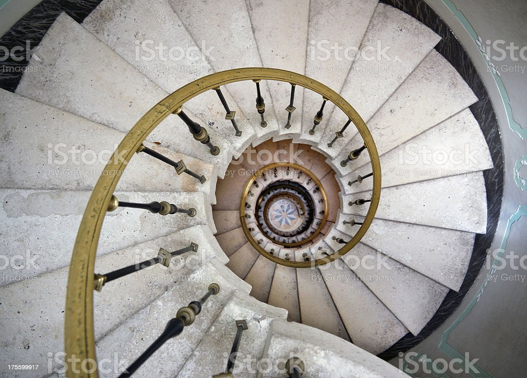Spiral staircase in old mansion.
