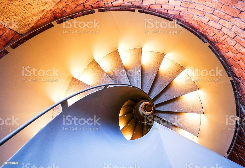 beautiful spiral staircase at a villa