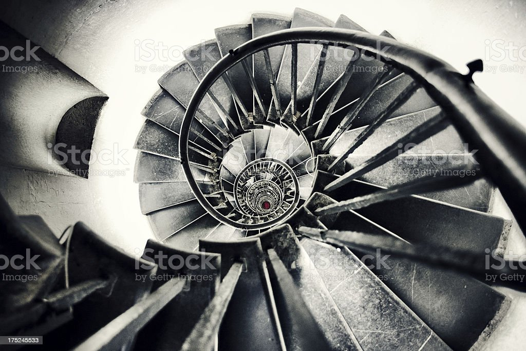 A view looking directly down through the centre of a spiral staircase
