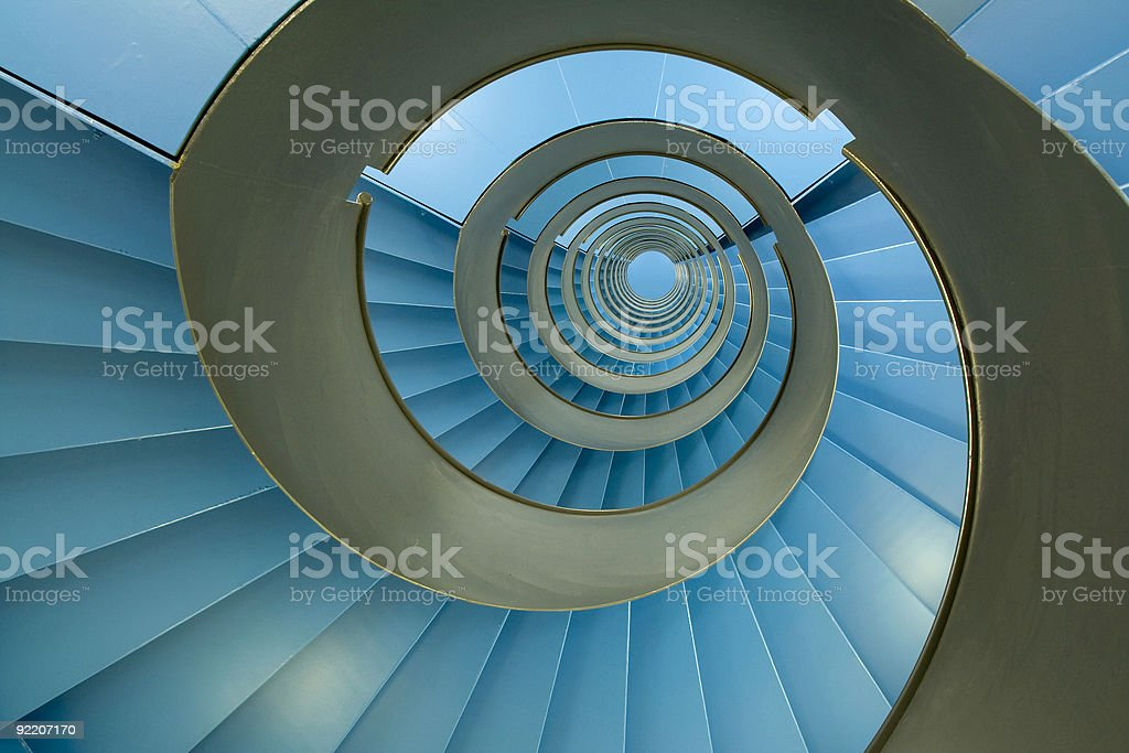 Spiral staircase with endless blue facets stock photo