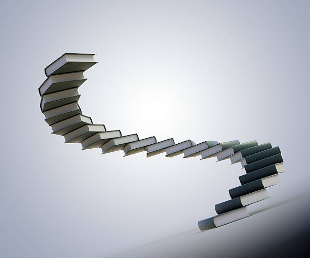 Spiral stairs made out of books stock photo