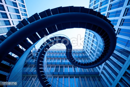 istock spiral stiars in front of modern architecture 171151710