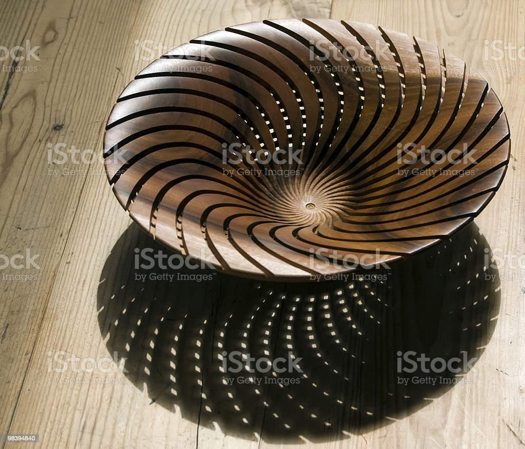 Spiral wooden bowl on table royalty-free stock photo