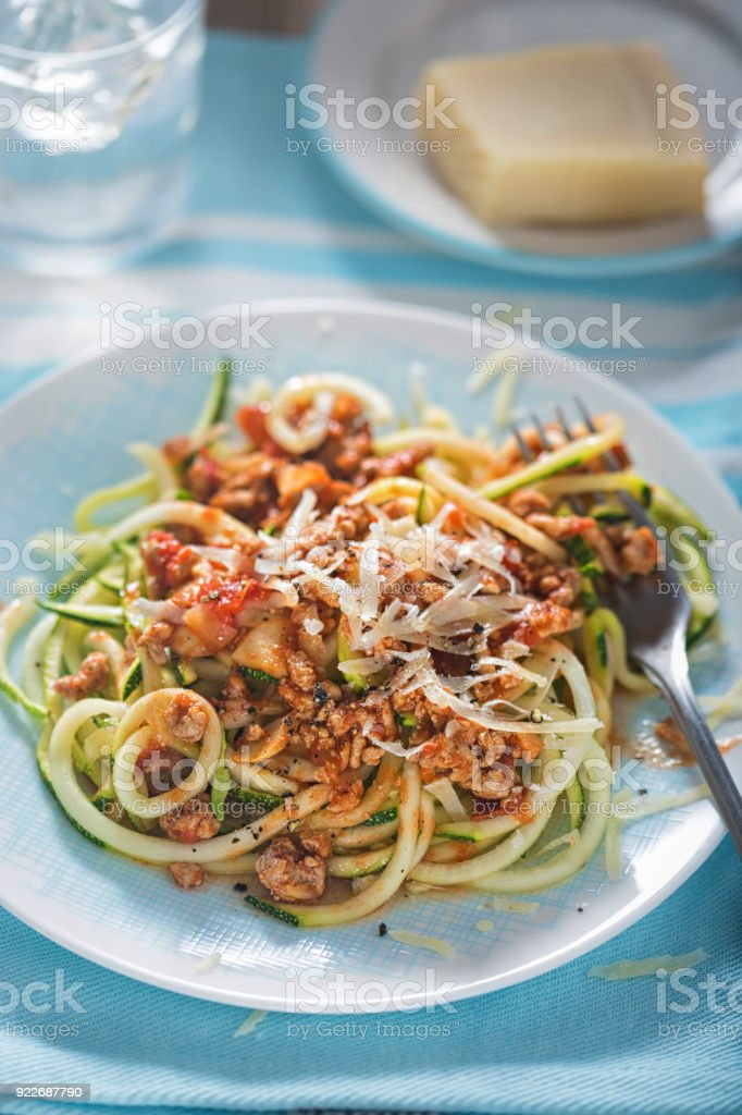 Spiralled courgette spaghetti with bolognese sauce stock photo