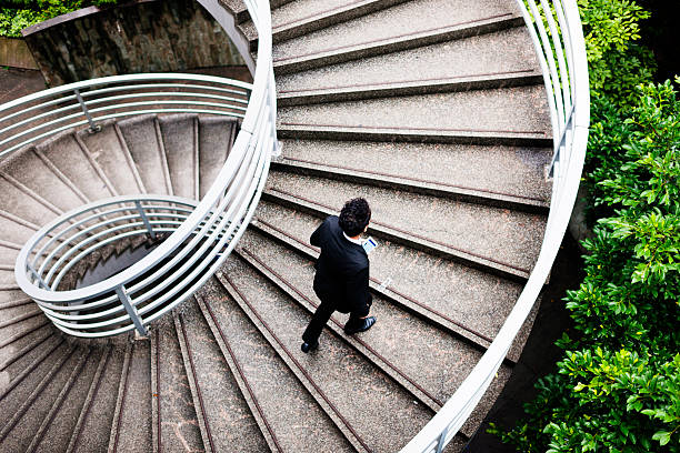 spiralling upwards - moving up stock photos and pictures
