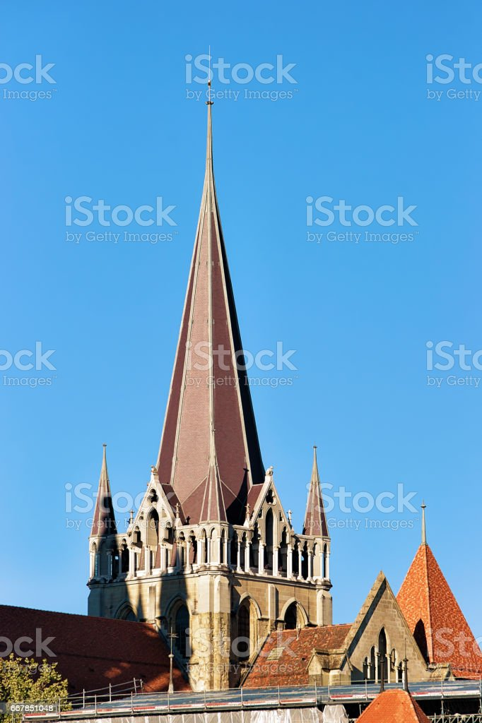 Spire of Cathedral of Notre Dame in Lausanne stock photo