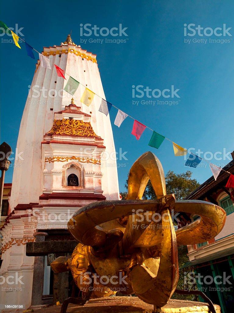 Spire of Swayambhunath Stupa and Vajra. royalty-free stock photo