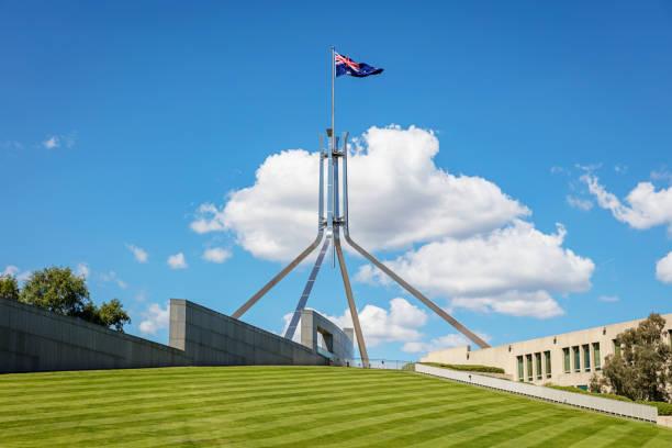 Spire with Australian Flag Australian Parliament Canberra Capital Hill stock photo