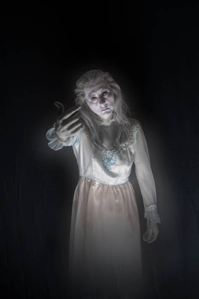 Spirit Calling in the Night A spirit of a creepy woman in a dress beckoning with her finer sdominick stock pictures, royalty-free photos & images