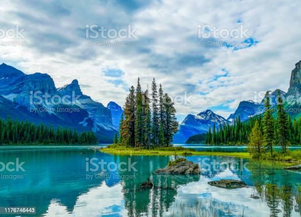 Photo of Spirit Island with Mount Paul and Monkhead Mountain, Maligne Lake, Jasper National Park, Canada
