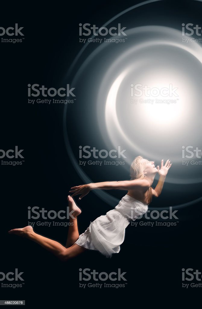 Spirit Woman Having Near Death Experience stock photo