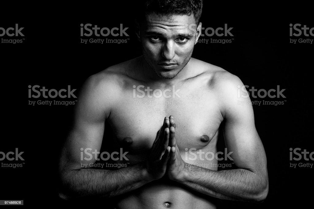 Spiritual portrait of man praying or doing yoga royalty-free stock photo