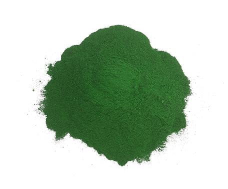 Spirulina algae powder isolated on white background. Top view