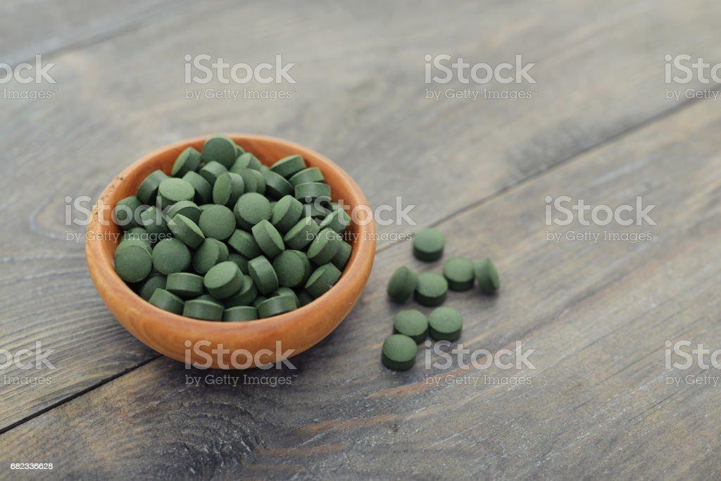 Spirulina in pills stock photo