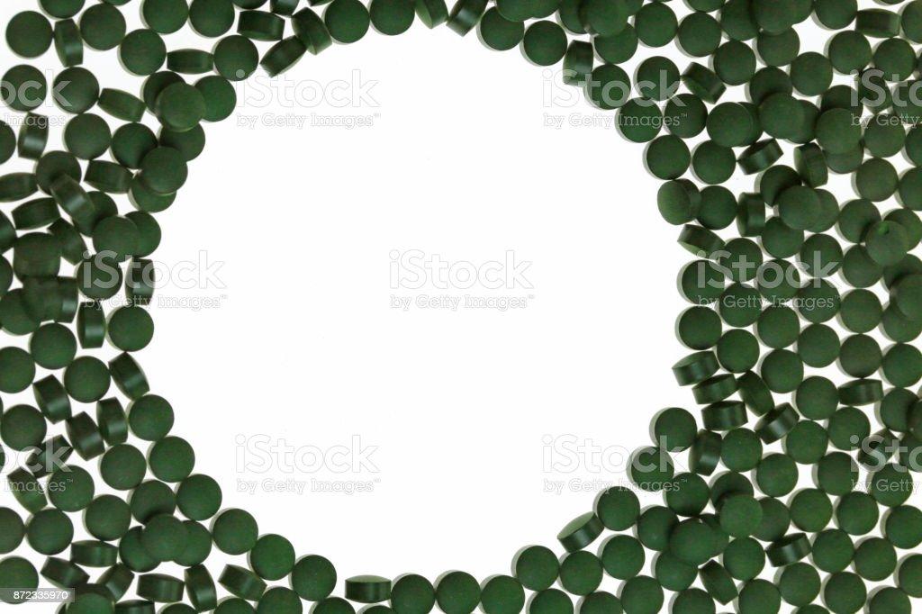 spirulina Mockup. mockup with alga spirulina in tablets . round frame...