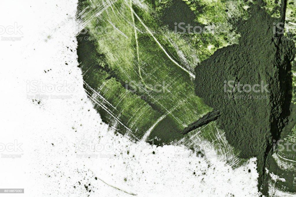 spirulina powder isolated on white background. spirulina abstract background stock photo