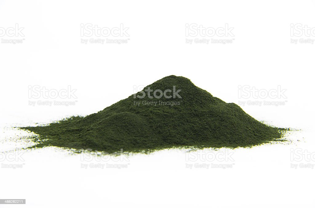 Spirulina powder on bright background stock photo