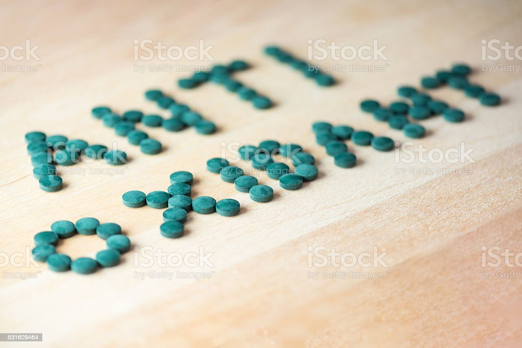 Spirulina supplement pills making up the word antioxidant stock photo