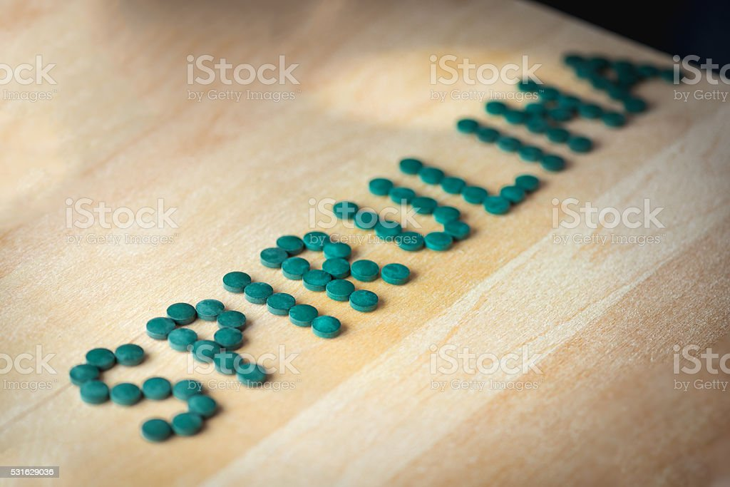 Spirulina supplement pills making up the word spirulina stock photo