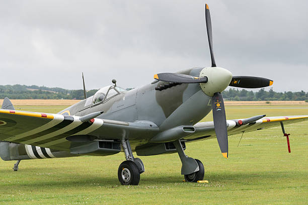 Spitfire fighter Duxford, UK - 13 July 2014: World War 2 vintage British Spitfire fighter plane at Duxford Flying Legends Airshow royce lake stock pictures, royalty-free photos & images