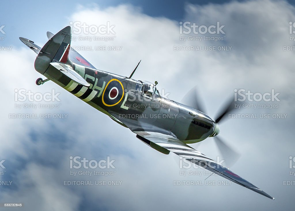 Spitfire MK912 in flight stock photo
