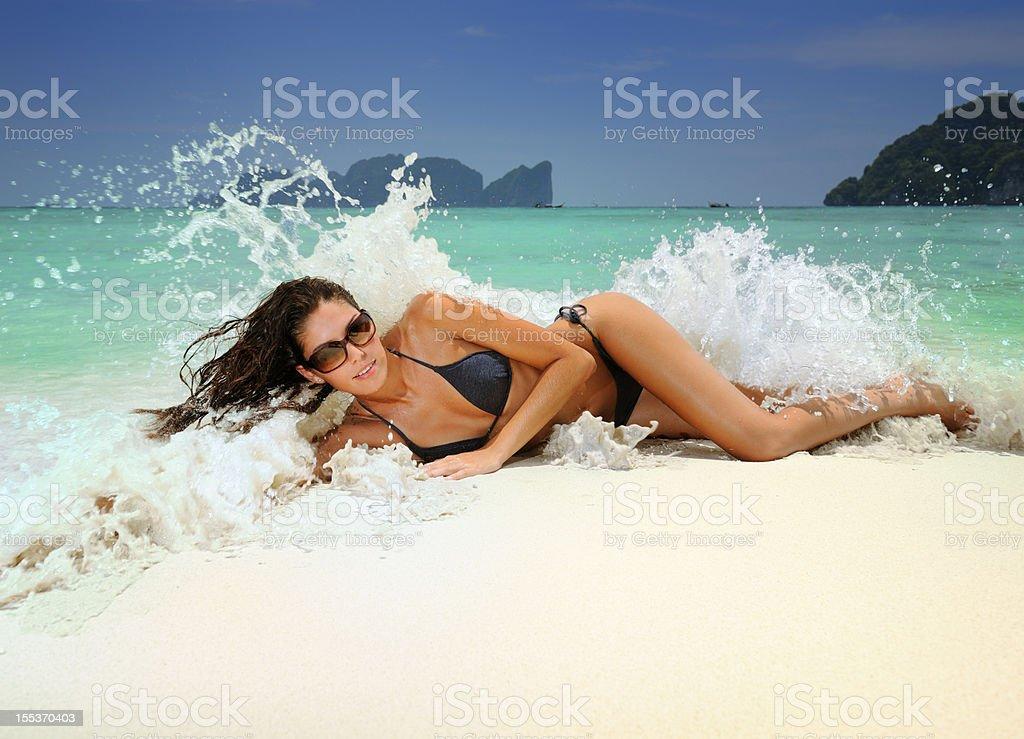 Splash! - Beautiful woman caught by a wave (XXXL) royalty-free stock photo