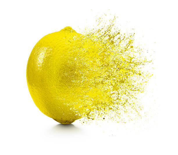 A splash coming off of a lemon on a white background Camera: Hasselblad lemon fruit stock pictures, royalty-free photos & images