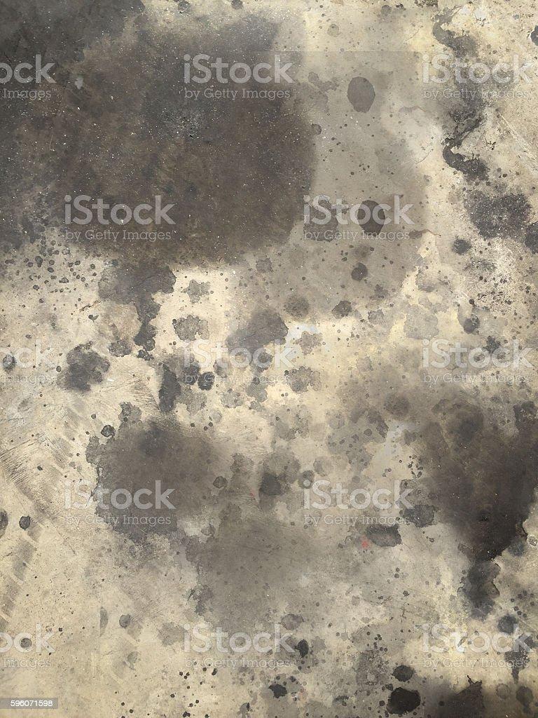 splash dirty oil stain on concrete floor royalty-free stock photo