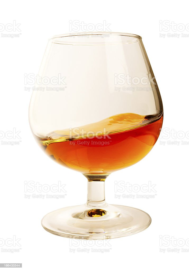 Splash in a glass of brandy royalty-free stock photo