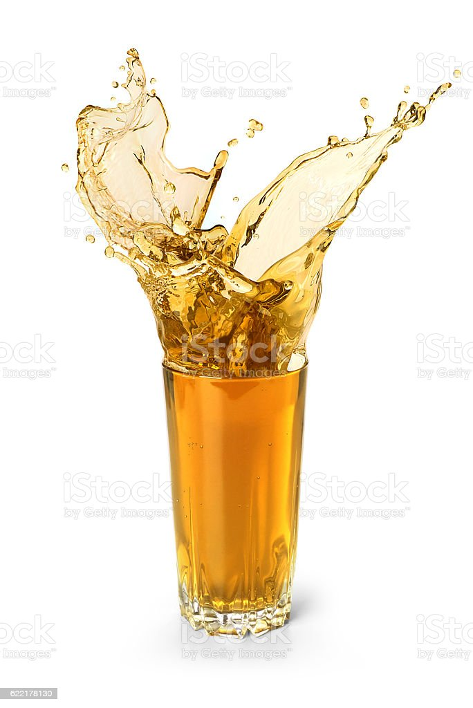 splash in a glass of juice stock photo