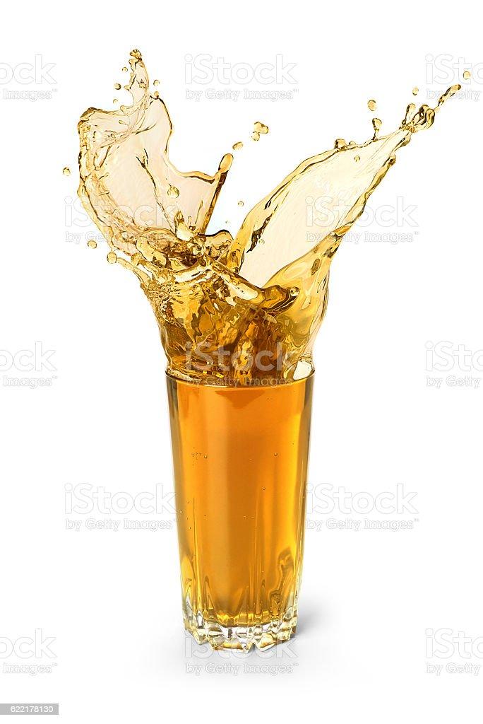 splash in a glass of juice – Foto