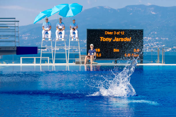 splash of a springboard diver - judge sports official stock photos and pictures