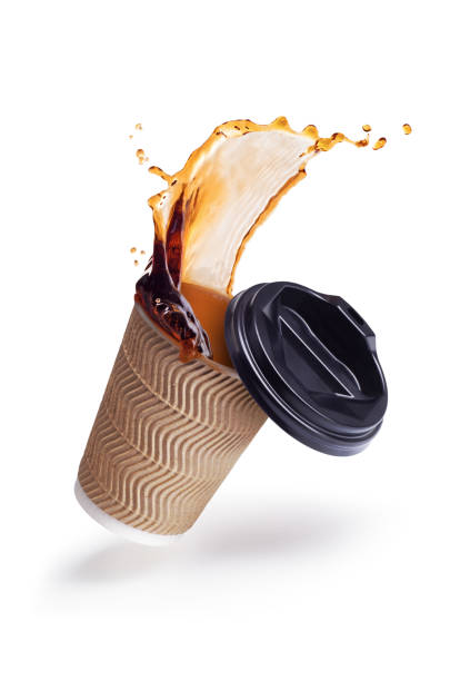 splash of coffee in a paper cup on a white background stock photo