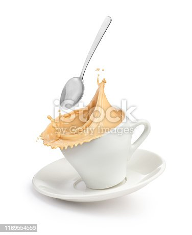 A splash of coffee with milk in a cup.
